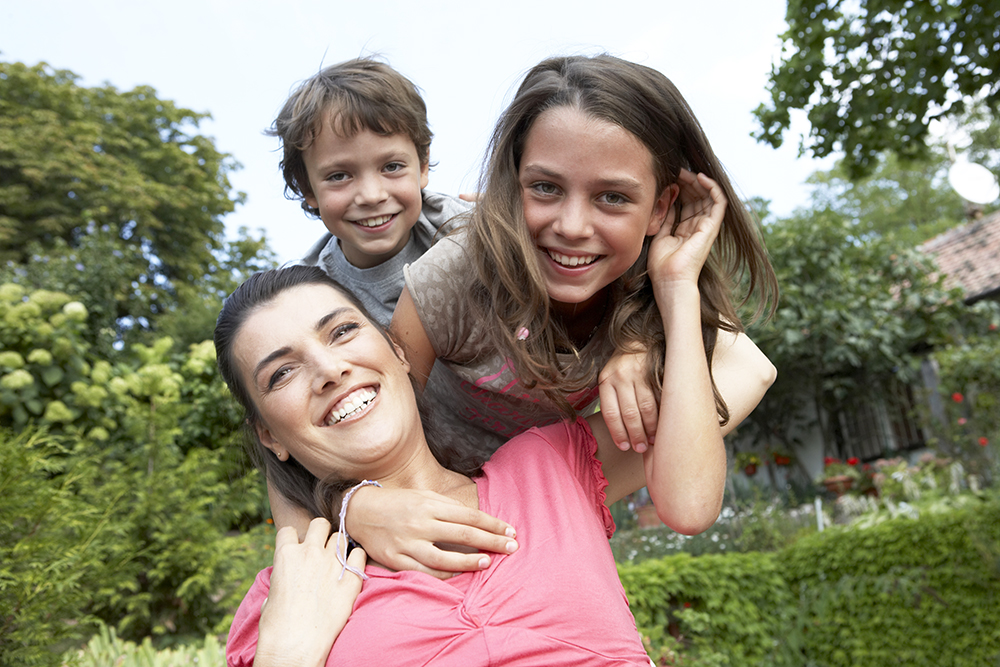 mother, daughter and son in garden